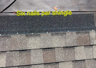 6 nails in the shingles of the roof