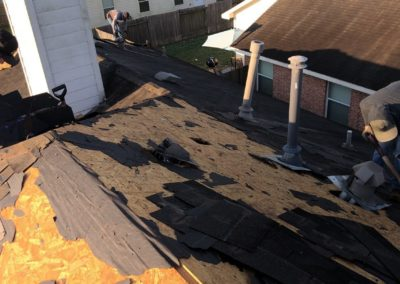 3 roofers repairing a residential roof